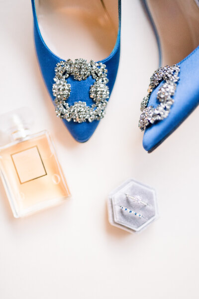 Wedding details photo with blue wedding shoes