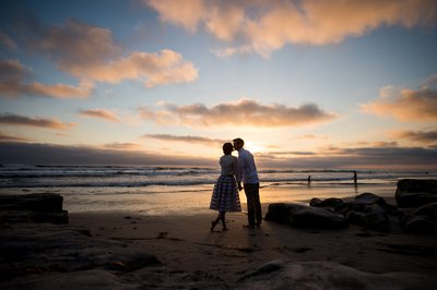 del mar engagement session of couple holding hands at beach