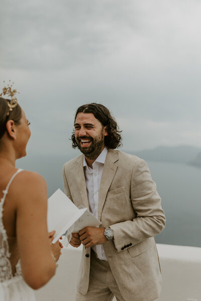 Groom laughing santorini