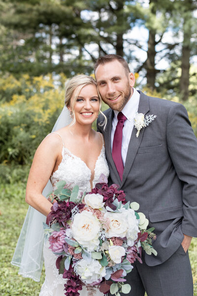 Bride & Groom with beautiful floral bouquet