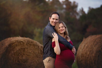 maternity session couple hay bale fisher farm park