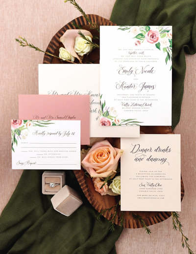 An elegant floral wedding invitation featuring hand-painted watercolor roses, lavender and beautiful flowing greenery. Showing 5 piece suite.