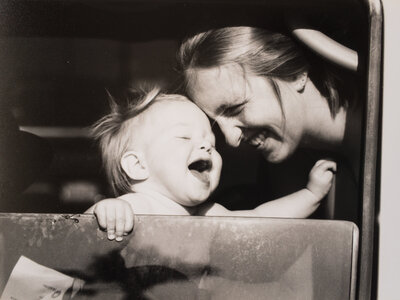 mom and baby laughing