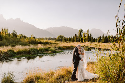 elopement at schwabacher landing in grand teton national park at sunset with mountains in the background