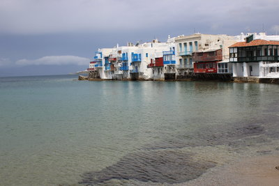 White buildings with colorful accents in Little Venice, Mykonos