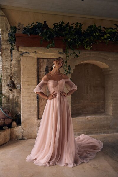 Rustic and refined is Sierra, she is the essence of nature not just in the way she moves, but in the way she inspires and holds lasting wishes. Bold volume sweeps through the train while a sculptured off-the-shoulder bodice is balanced beautifully with the dainty sleeves puffing weightlessly. Sierra is the colour of fate waiting patiently for a soiree of country charm.