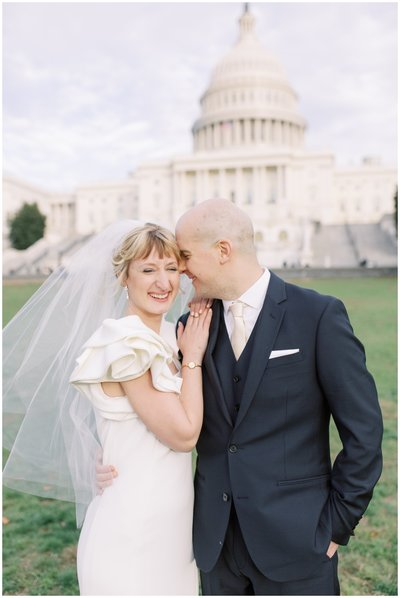 Bride and Groom posing at the U.S. Capitol. Laughing and smiling pose.