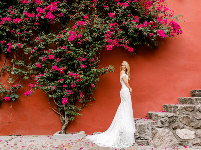 smiling bride against red wall