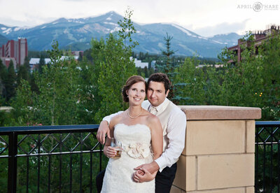 Couple pose in front of mountain view at Breckenridge's Main Street Station Wedding Venue in Colorado