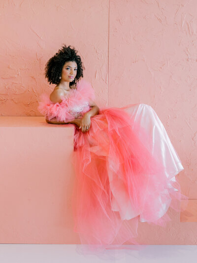 model posing in hot pink tulle dress