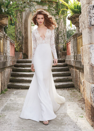 Tara Keely by Lazaro bridal gown - Ivory Venise lace and crepe sheath bridal gown, long sleeve bodice with cashmere lining and deep V plunge neckline, slim skirt with chapel train.