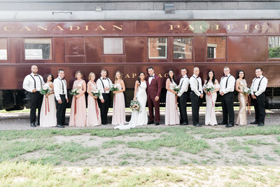 Big bridal party in from of train at Steam Whistle Brewery Wedding