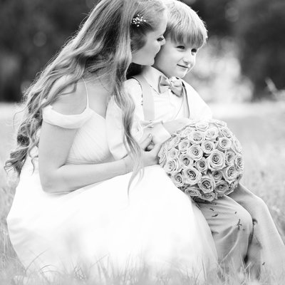 bride holding ring bearer