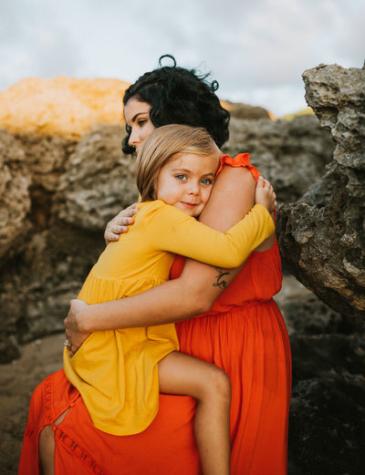 Family Photography Oahu Hawaii, mother and daughter sitting together
