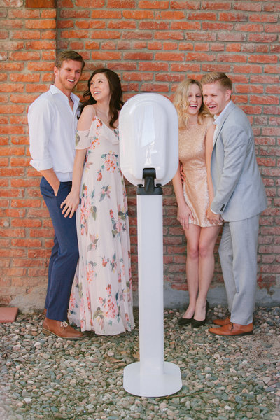 couples smiling at photobooth