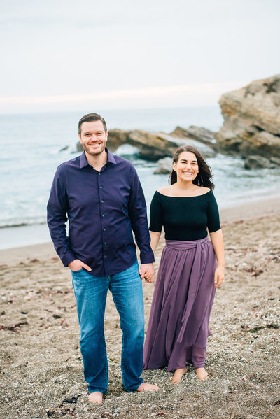 Marianne and Joe standing on the sand in Central California Smiling