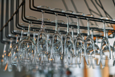 close-up-image-of-a-wine-glasses-hanging-in-the-ba-EAYDNE7