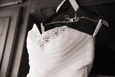 Wedding dress on hanger. Photo by Ross Photography, Trinidad, W.I..