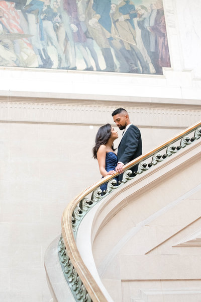 Engagement portrait on staircase at m.I.c.a.