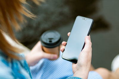 Canva - Woman Holding Black Smartphone With Black Screen