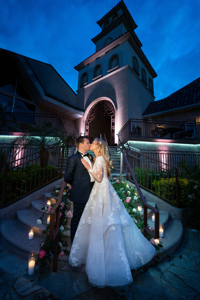 Couple kissing at night at their wedding at South Coast Winery Wedding venue in Temecula