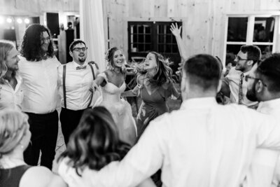 Bride and groom dancing with guests in a circle | The Barn at Timber Creek in Farmville Virginia
