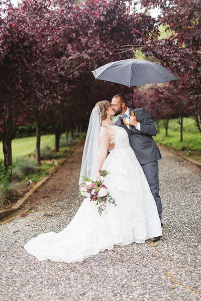 romantic couple dipping with umbrella on day