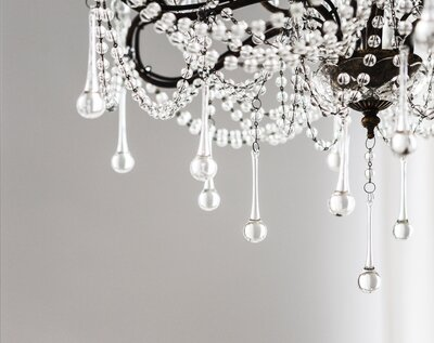Contemporary crystal chandelier in room interior_edited