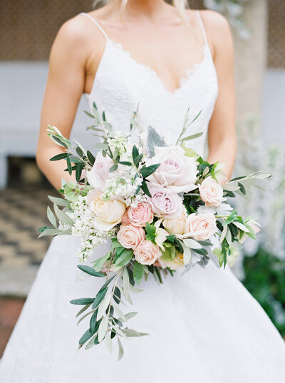 Bride holding a blush and ivory wedding bouquet