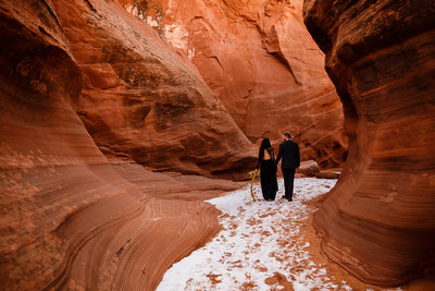 Couple exploring a slot canyon in Arizona on their adventure photo session.