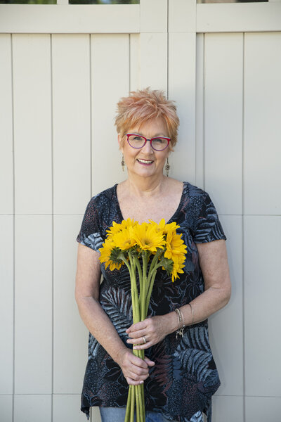 Jane Shine with yellow flowers