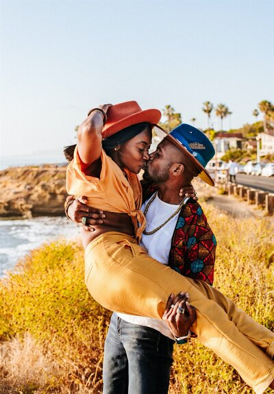 socal-standard-black-love-black-couple-bougie-burning-man-stylish-black-girl-magic-gold-pants-wood-fedora-sunset-cliffs-san-diego-couples-shoot-jeep-afropunk-marriage (1)