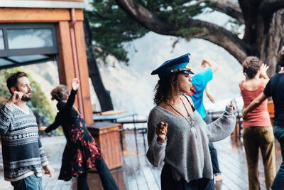 Woman Dancing on New Esalen Lodge Deck in the Rain
