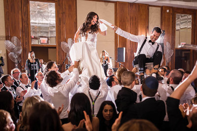 Jewish wedding photography during hora at Toronto wedding