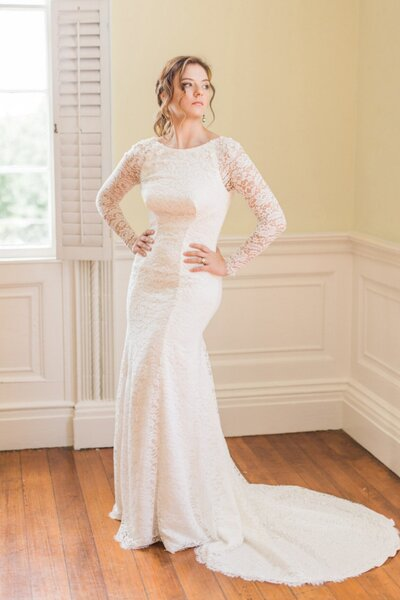 Model wearing the Hudson all-lace wedding dress with long sleeves