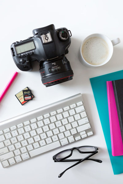Professional camera on the desk in branding and website design studio for photographers