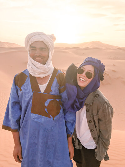 A traveler with a local in Morocco