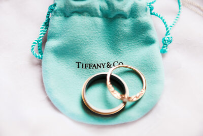 wedding bands on a tiffany & co. bag