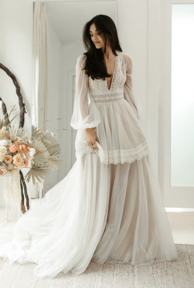 Custom vintage-inspired border lace trim adorns the very beautiful, very versatile Mesilla gown. This gown can be worn multiple ways with a removable second tier skirt.