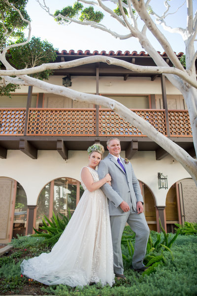 Bride and Groom in greenery at their  wedding at the La Jolla Shores Hotel
