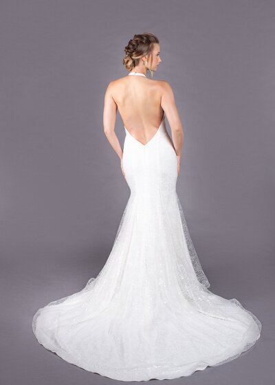 Photo link to more details about the Marlene mermaid wedding dress with a halter neckline and low open back