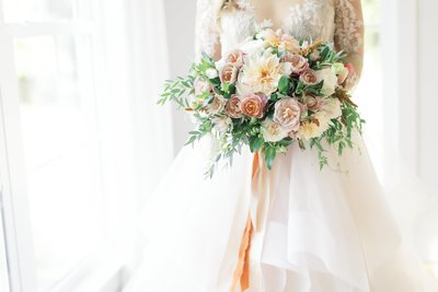 Wedding pictures of bridal bouquet, Fine art photography, Floral bouquet with greenery, mustard color,  pinks, creams, white, and blush.  Wedding in Virginia,  photographed by Bakersfield wedding photographer Marianne Lucas