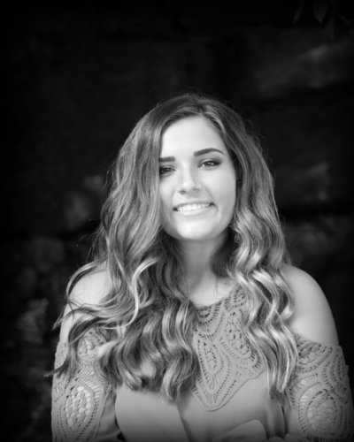Senior Portraits of girl in black and white and curly hair