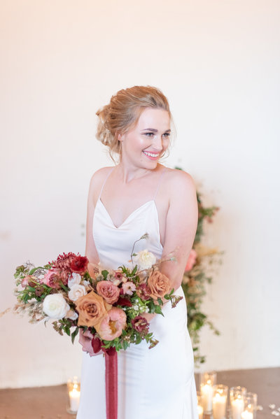 bride holds bouquet at venue at washington