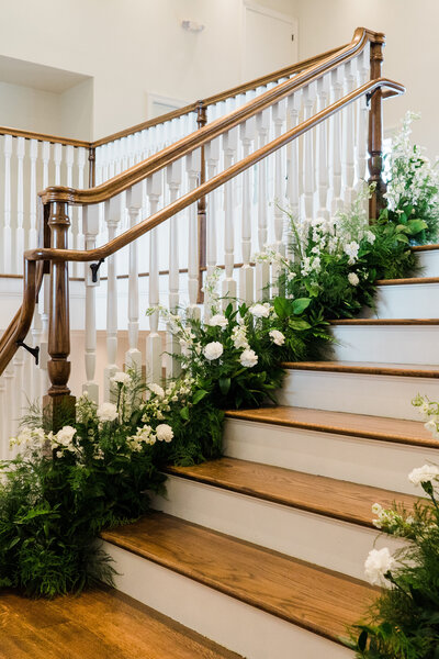 Romantic staircase surrounded by flowers