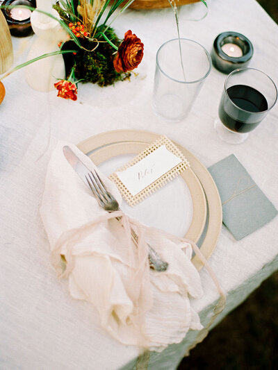 White ceramic plates with unglazed edges from Farmhouse Pottery for an organic fall wedding