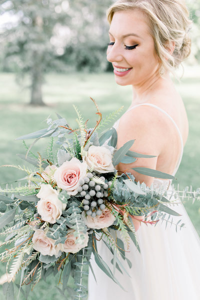 bride holds bouquet at Hidden Vineyard wedding photo by Grand Rapids wedding photographer Cynthia Boyle