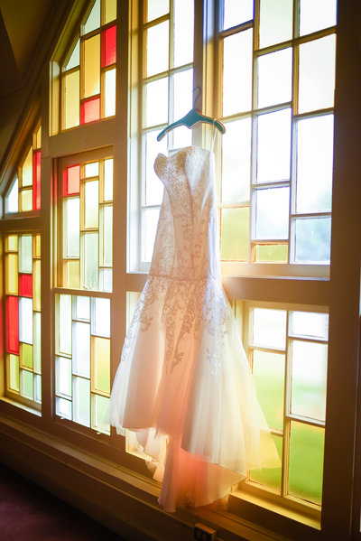 Bridal Gown on Stained glass at Mississippi Wedding