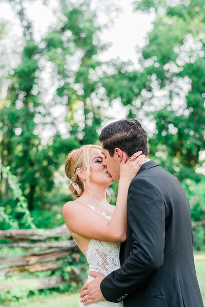 bride and groom share kiss for initmate micro wedding in husdon valley, ny