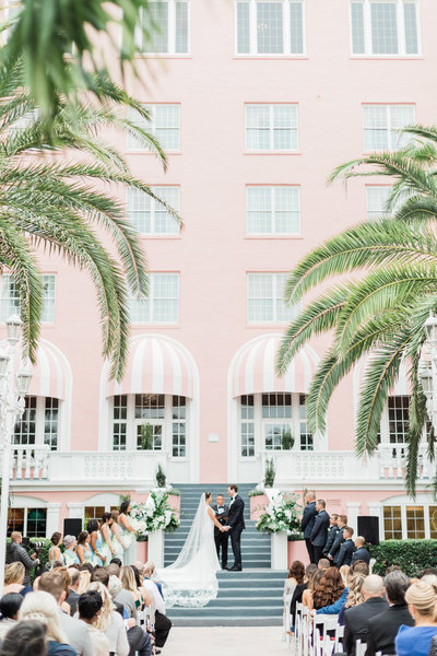 ceremony in courtyard of don cesar in st petersburgh florida wedding by costola photography